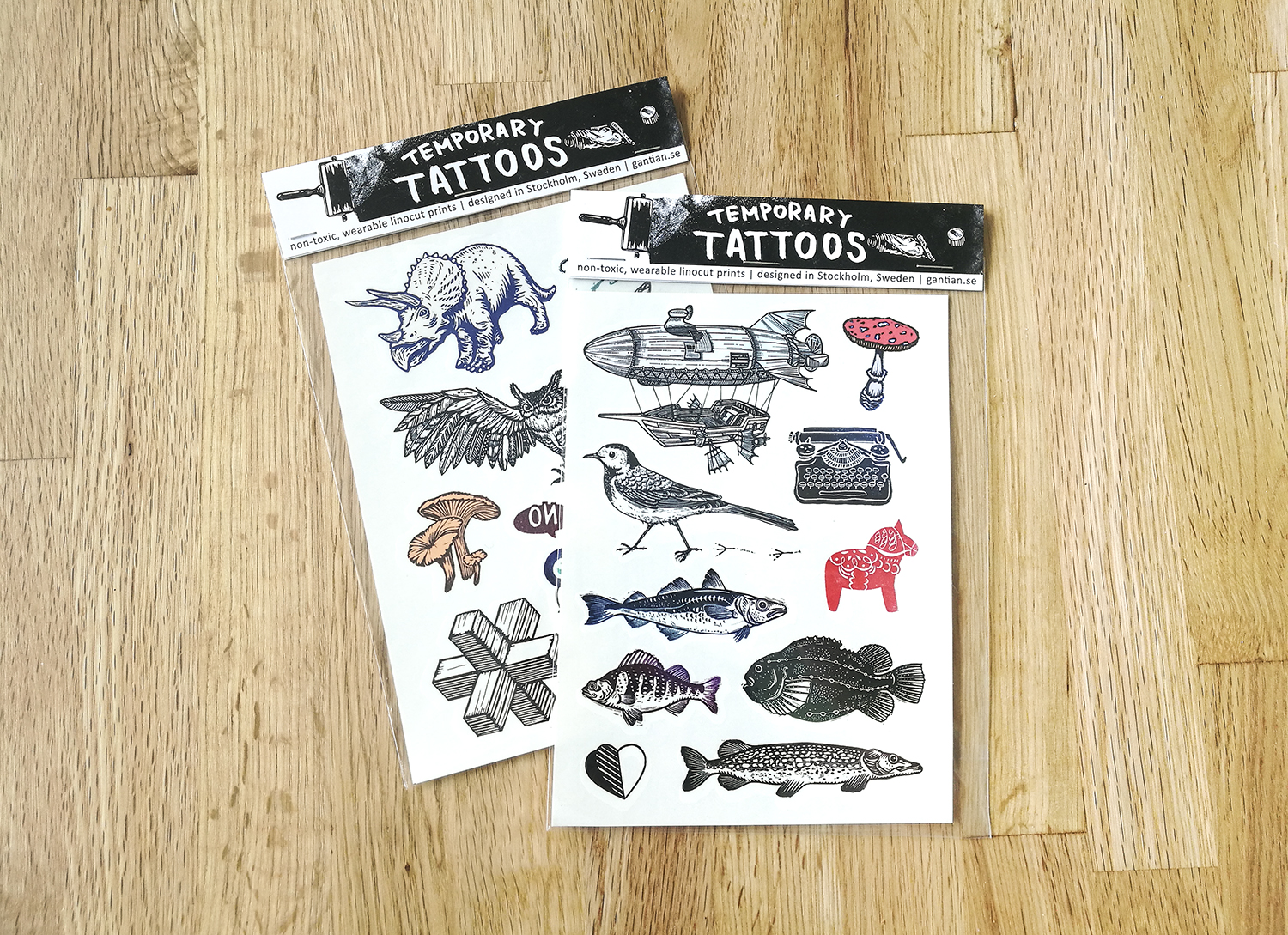 Two temporary tattoo sheets based on Tian's linocut designs.