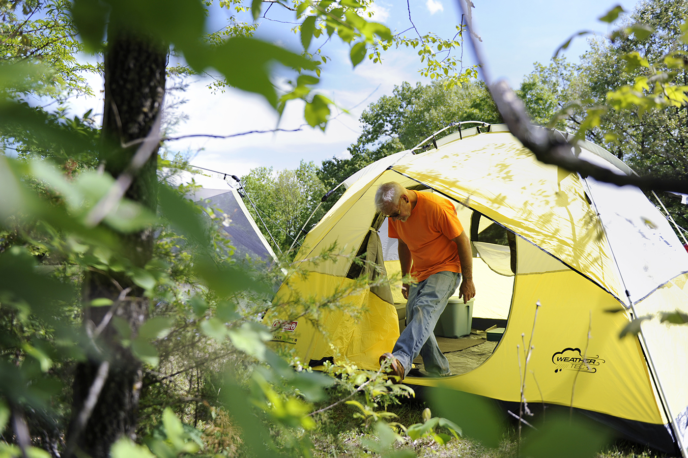 """George Bunyea sets up his tent on a portion of Oak Spirit Sanctuary's 160 acres in preparation for the fertility festival, Beltane, on Thursday, May 4, 2017. The sanctuary makes a large portion of its money from big festivals such as Beltane in the spring, and Harvest in the fall where participants pay an entry and camping fee. Bunyea thinks that the community welcoming outsiders is a positive and necessary step for the church. """"We're moving toward inclusive and not exclusive. Exclusive was getting' us broke. And it's done that to every pagan place if they haven't survived. And they did it for years because they're afraid of the outside world,"""" Bunyea said."""