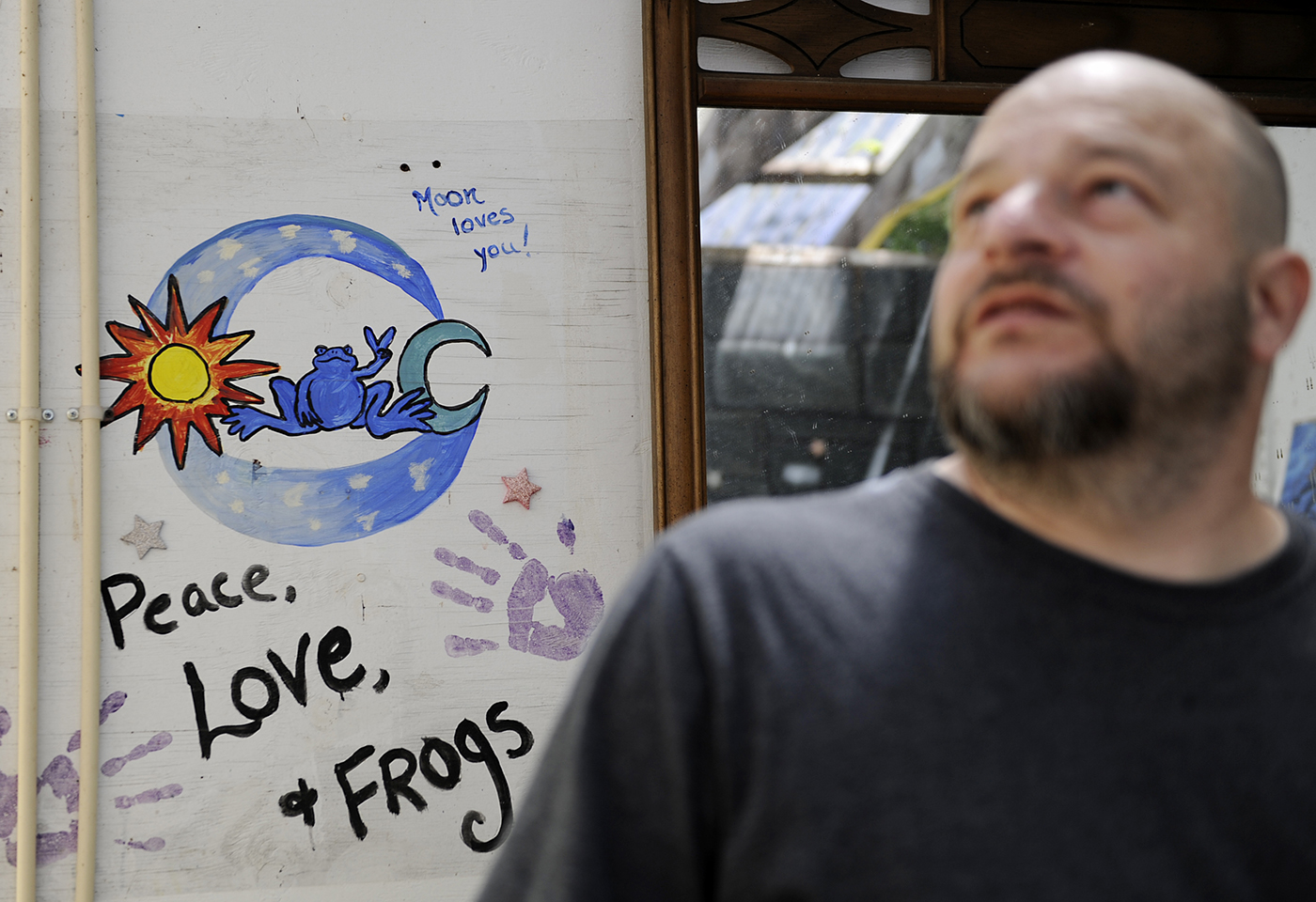 """Michael Carroll looks around at the shower house, dubbed the """"frog bog"""" while fixing up the showers on Thursday, May 4, 2017. Not everyone in the community practices Wicca, but still come to Oak Spirit for the rituals and fellowship. Carroll suffers from fibromyalgia and spends extended periods of time confined to his bed, uses Oak Spirit to get out of the house. """"They're some of the most accepting people I've ever met."""" Carroll said."""