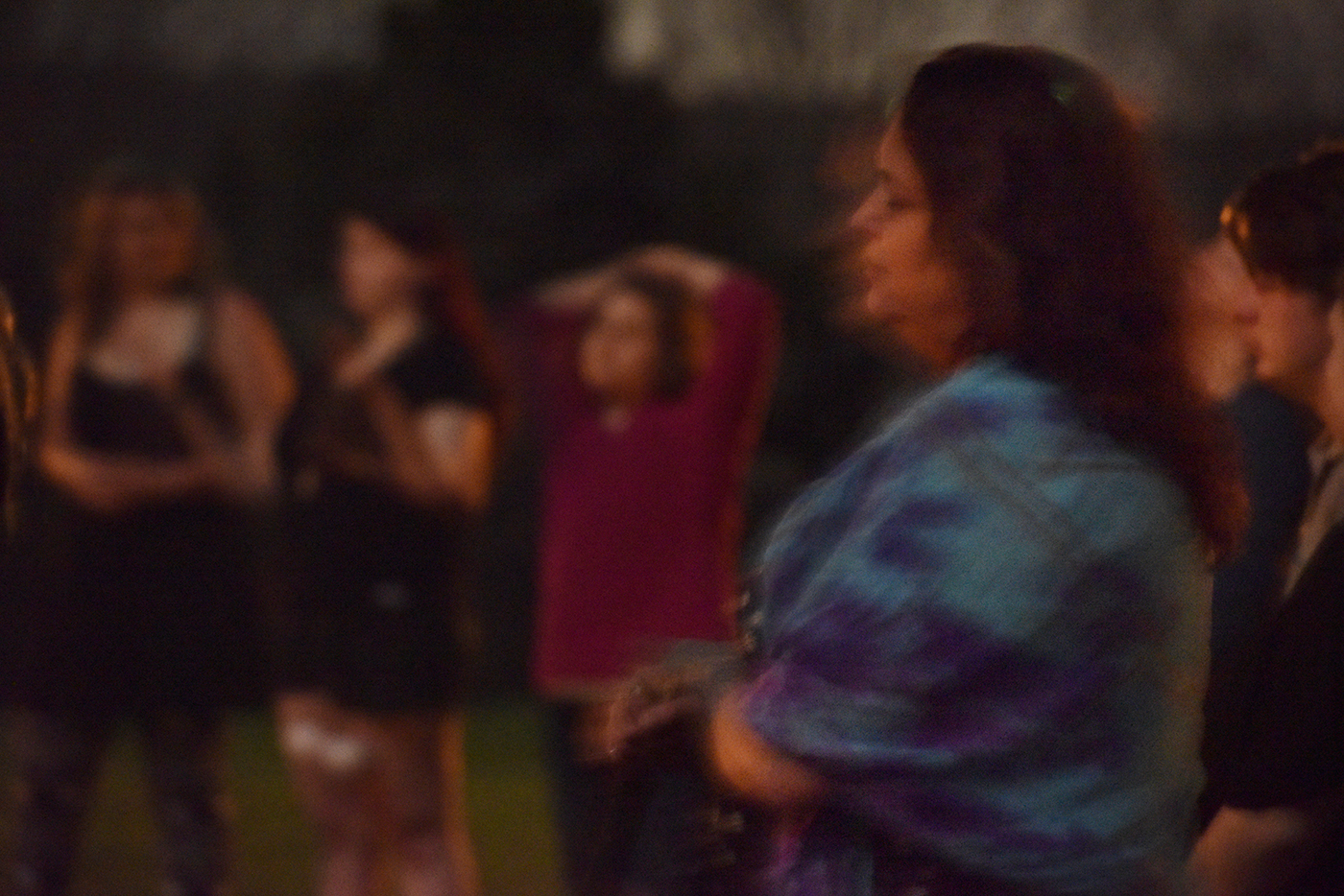 Priestess and witch, Kerry Lynn, sways while singing chants during a lunar gathering on Saturday, April 8, 2017. Lynn grew up Catholic and similarities with Catholic traditions can be found within Wicca ceremonies since Christianity was adapted from paganism.