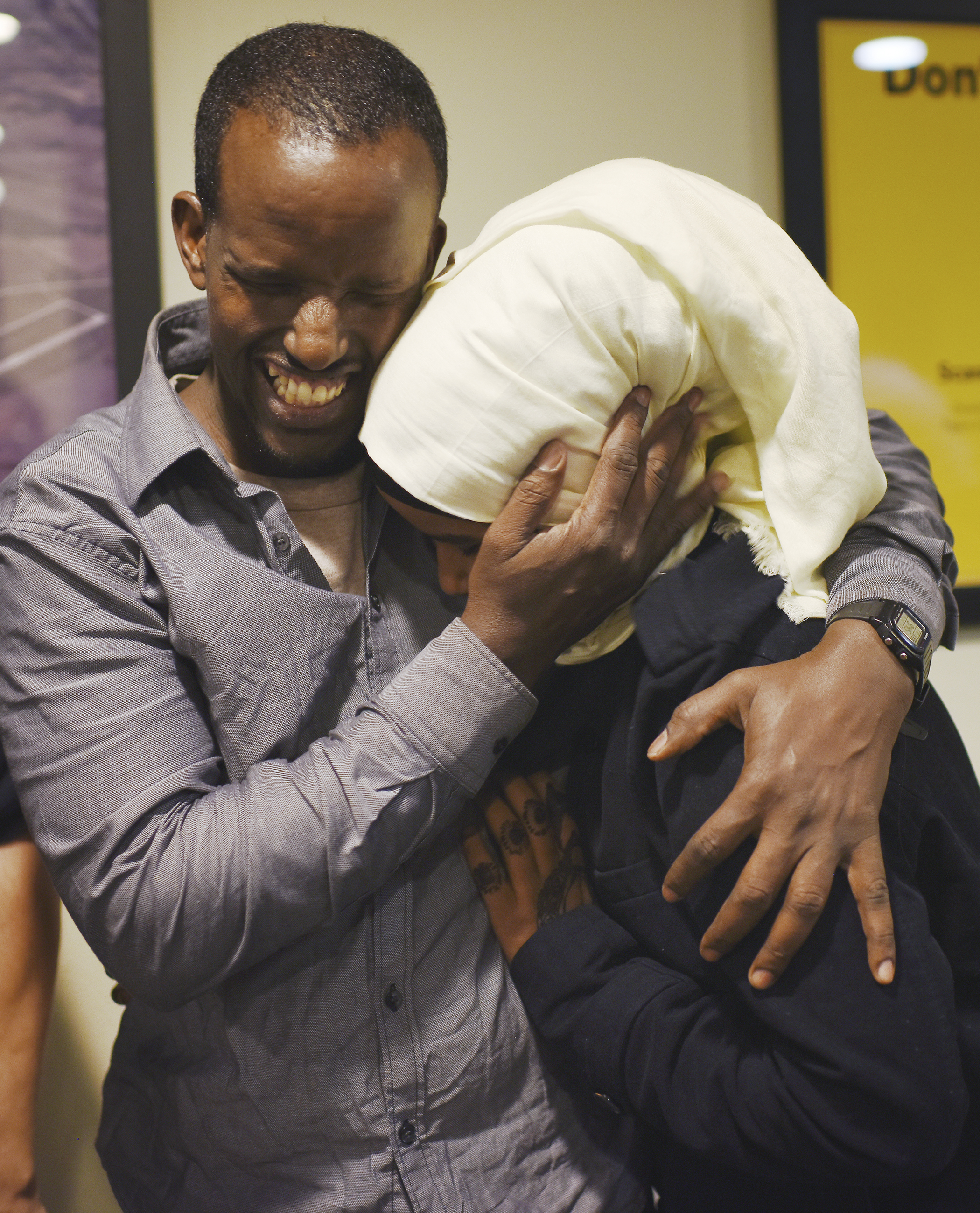 "Somali refugee Abshir Abdirahman hugs his daughter, Iqro Abdirahman(cq), 13, in the Columbia Regional Airport while being reunited after nine years of separation on Friday, Feb. 17, 2017. Abshir has been in America for three of those years. ""It was only after I saw my wife that I recognized those were my kids,"" Abshir said.  v"