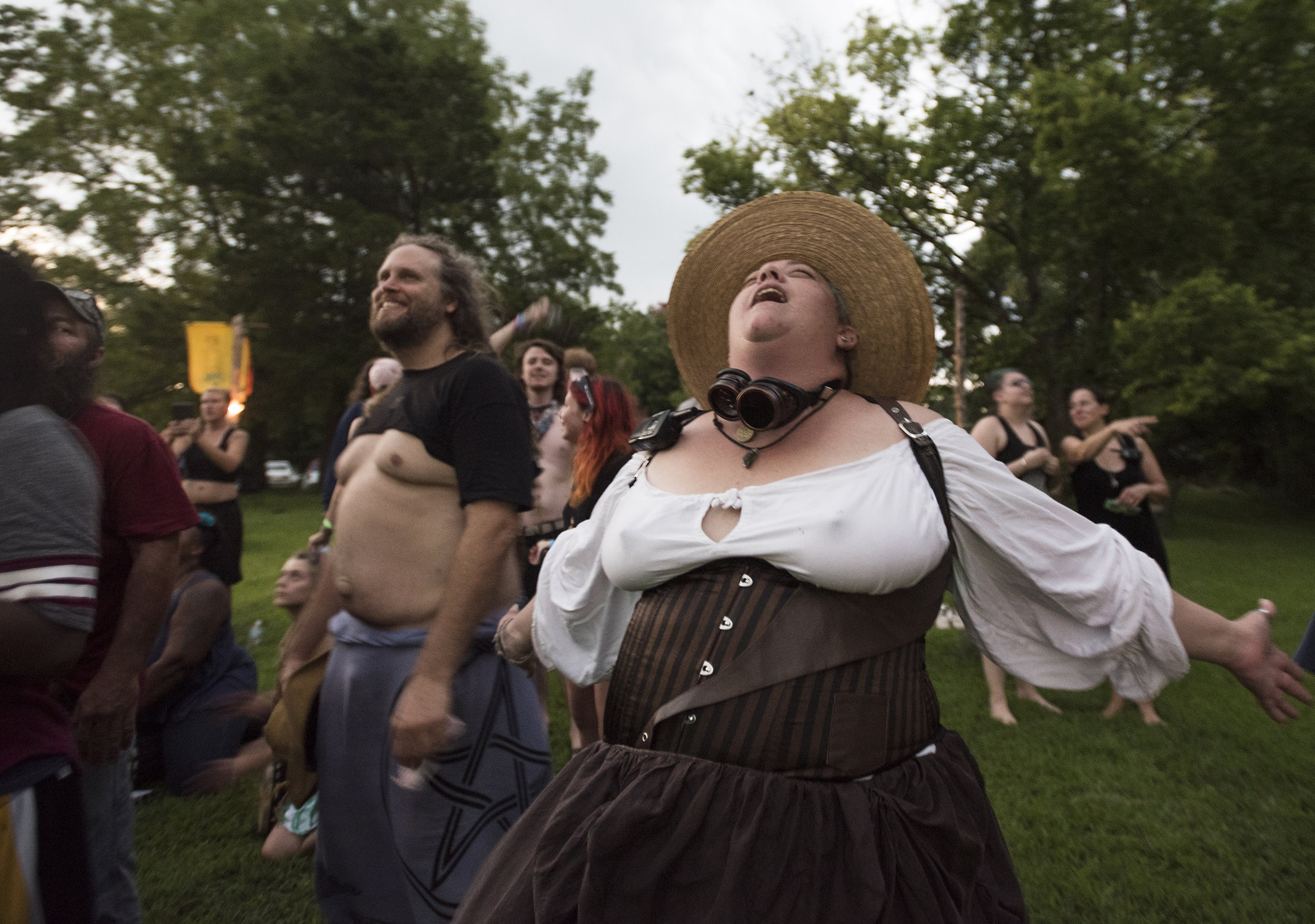 Nicole Blank yells to the sky as the sun disappears behind the moon and totality is reached at Oak Spirit Sanctuary in Wooldridge, Missouri on Monday, August 21, 2017. Blank describes herself as an eclectic witch, meaning she does research on all aspects of paganism but does not subscribe to a specific doctrine.