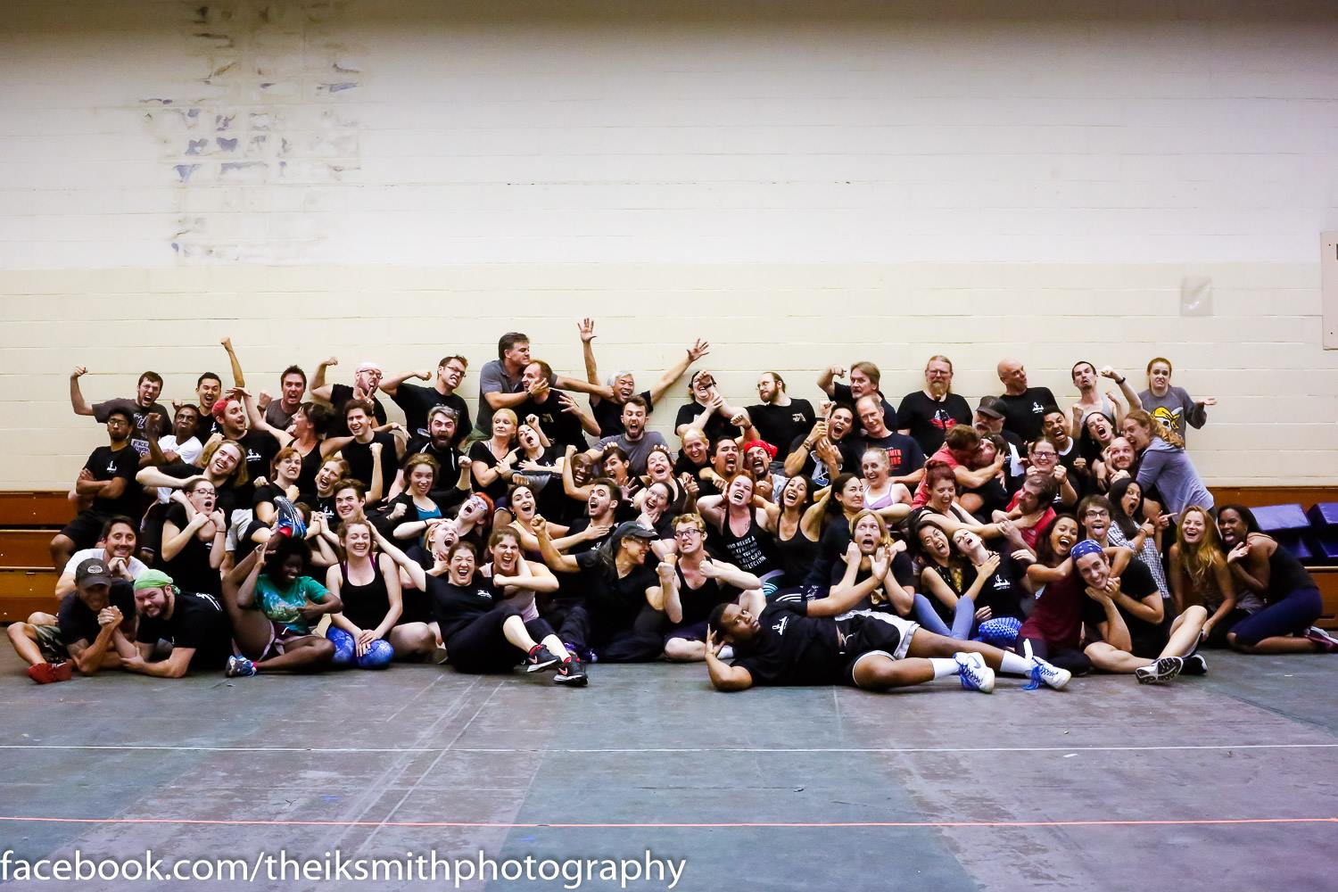 "We took a few smiling ones, and then I believe the direction we were given was ""victorious"" which apparently to a group of fighters means aggressively violent. (I'm just to the right of center about two rows back exchanging hair pulls with my dear friend Carlotta.) Photo credit: Theik Smith Photography"