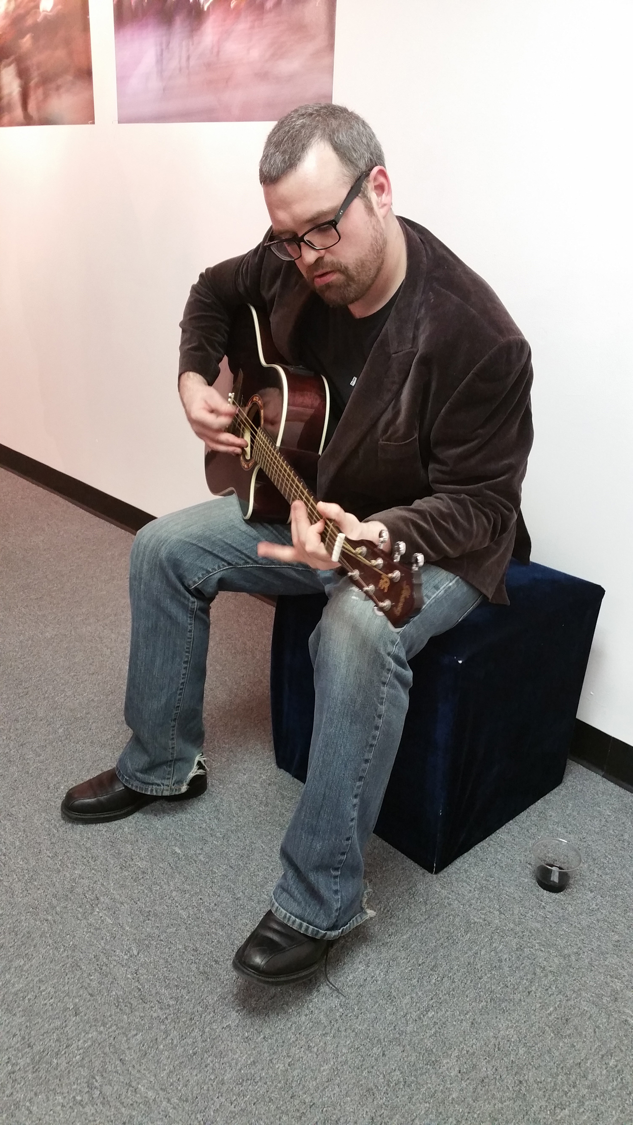 Michael DiFeo  of Jersey City provided a solo acoustic guitar performance and as well as an abstract photographic art exhibit.  Photo by Lenore Holz.
