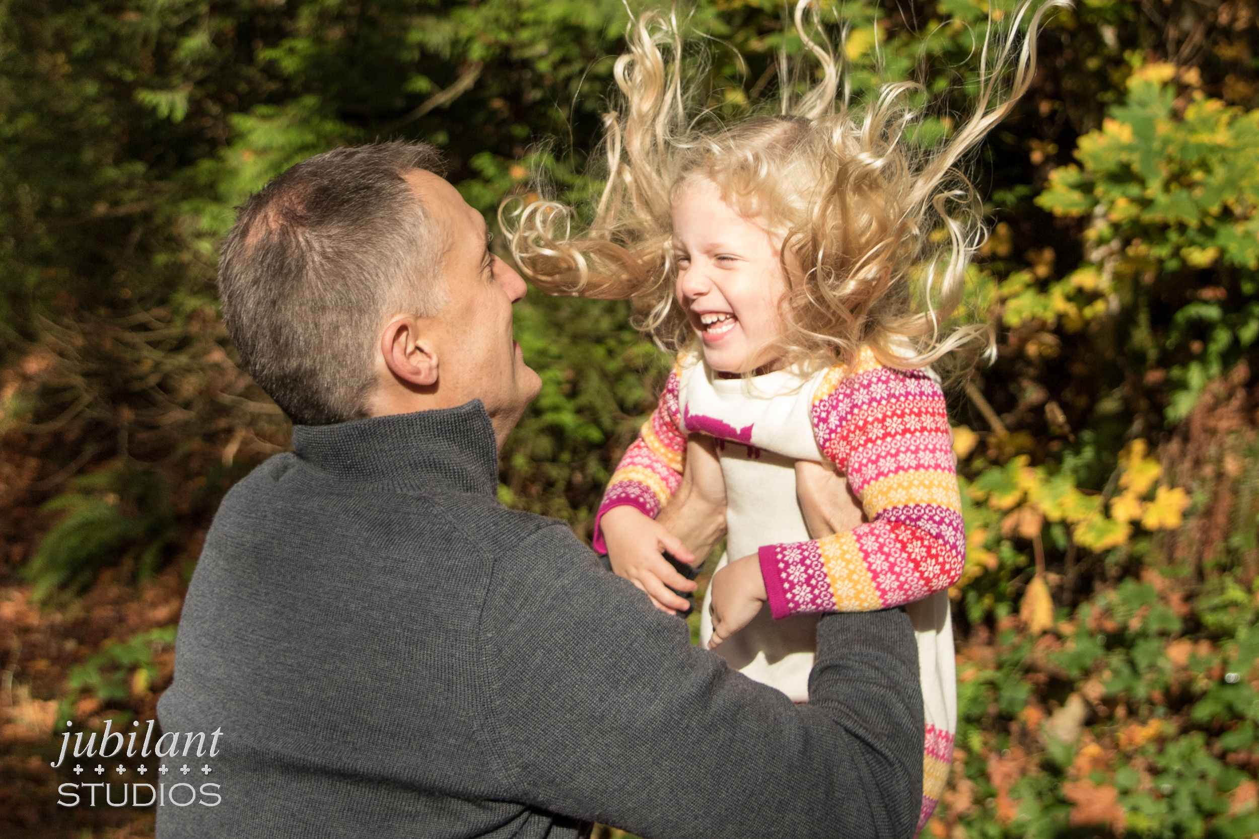 Child Tossed Into Air Family Photographer