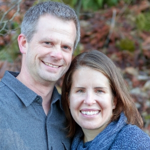 Smiling couple on blurry background - portrait photographer seattle