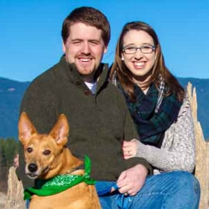 couple with dog on sunny day - family photographer north bend