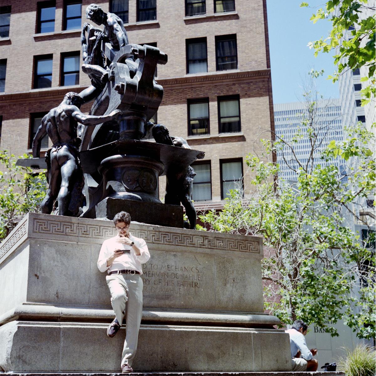Man on a Phone Against Mechanics Monument