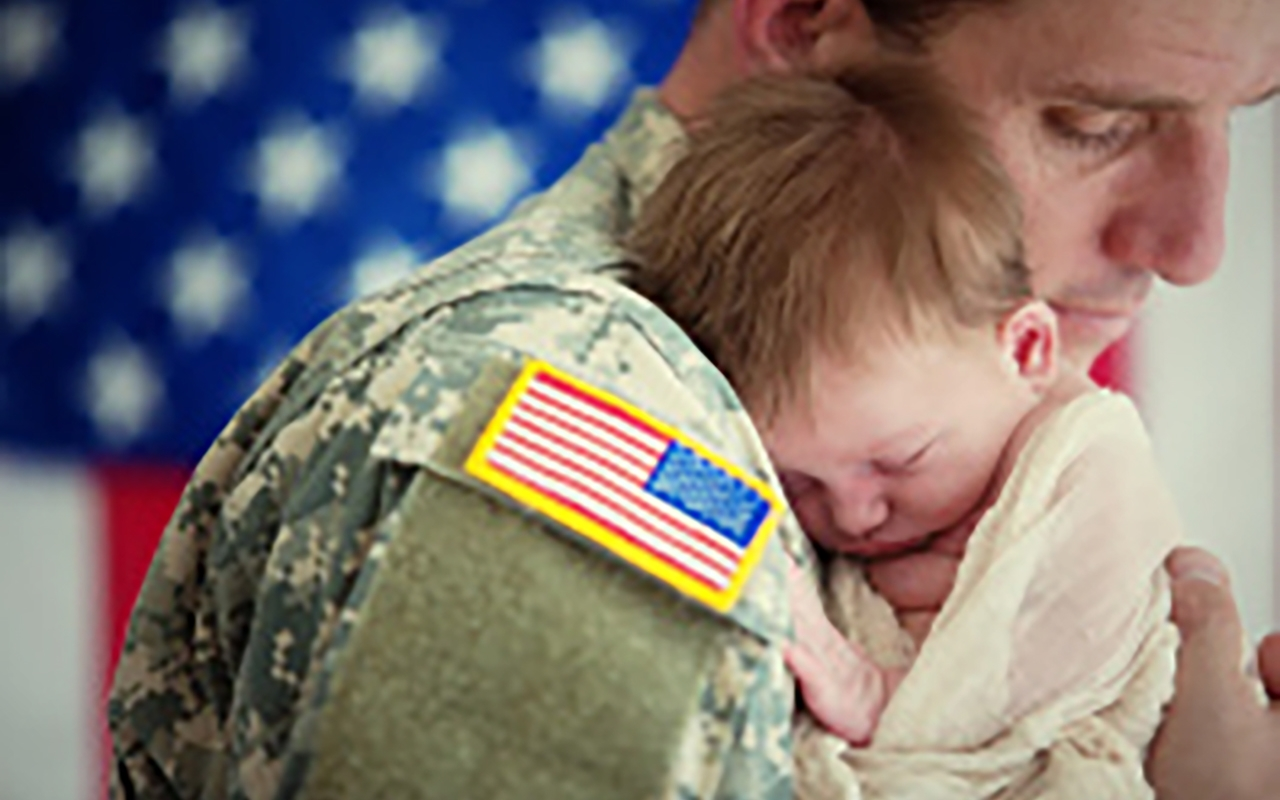 comp box 2stock-photo-40859376-american-soldier-holding-newborn-baby.jpg