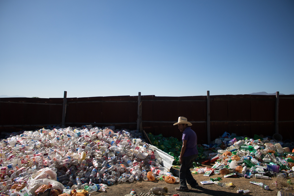 Eliseo Vargas, 35, stands near the pile of plastic he recently collected  in Zaachila, Mexico on Friday, Jan. 13, 2017. Eliseo sells the recyclables to a nearby facility and the money he earns is the Vargas's main source of income.