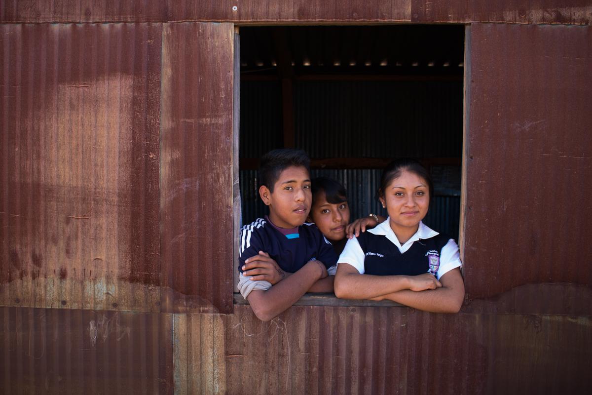Abdiel Vargas, 13, Yanitza Vargas, 13, and Deysi Vargas, 15, pose in the window of the family kitchen in Zaachila, Mexico on Thursday, Jan. 12, 2017.