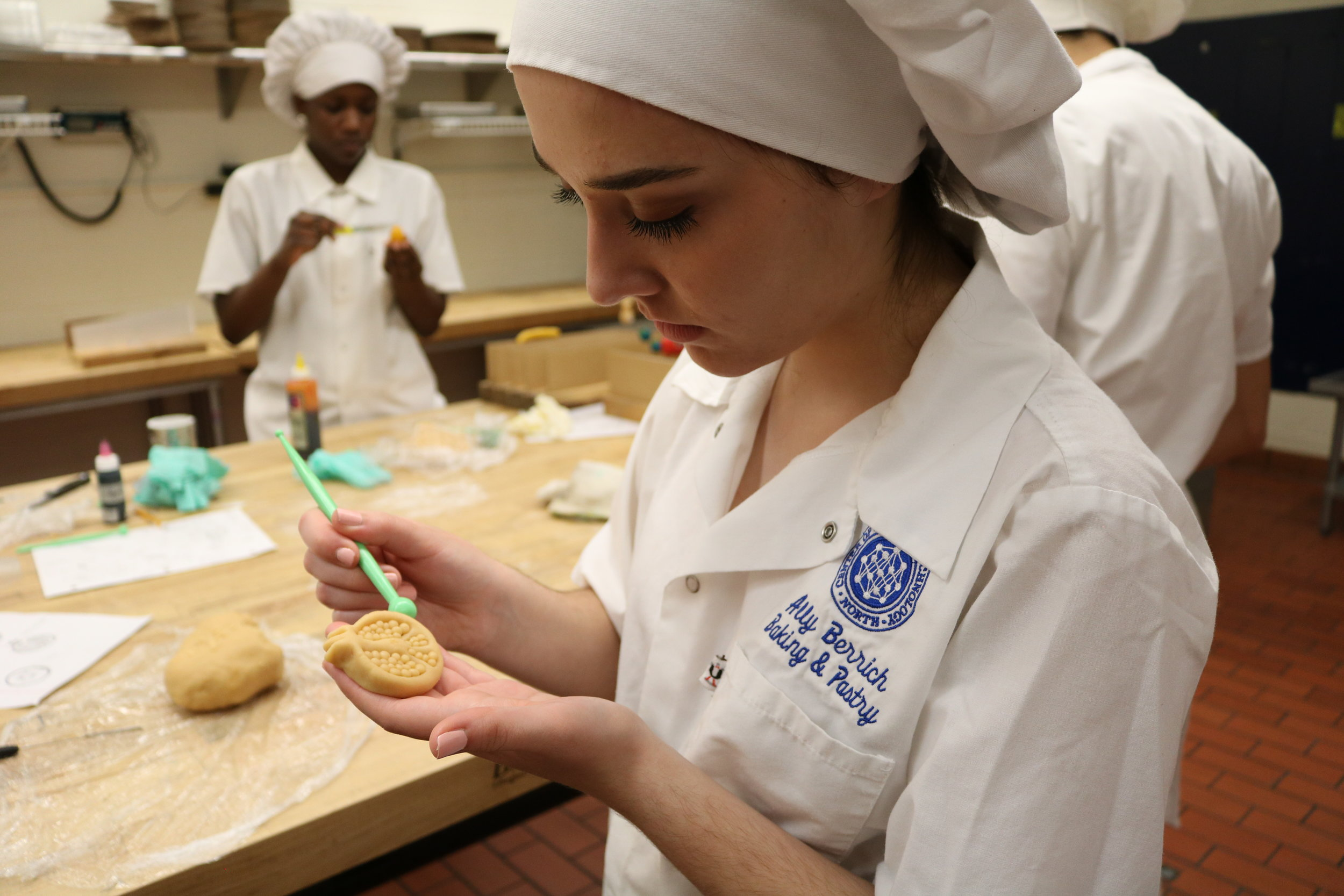 Ally Berrich, 17, forms a pomegranate out of marzipan in her baking and pastry course at the Center of Applied Technology North in Severn, Md., on May 5, 2016.