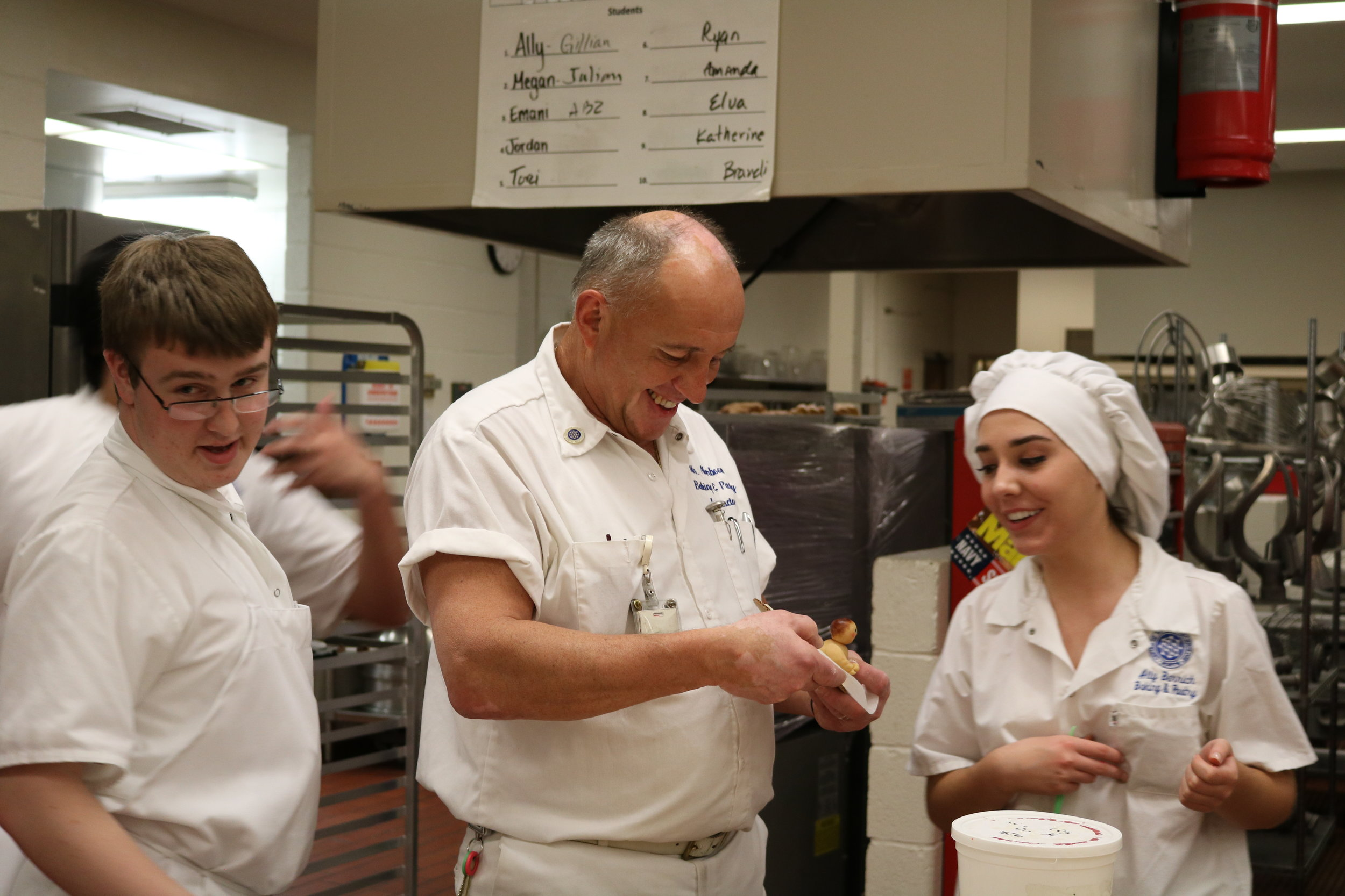Peter Akerboom, center, makes a marzipan joke with Ally Berrich in a baking and pastry course at the Center of Applied Technology North in Severn, Md., on May 11, 2016