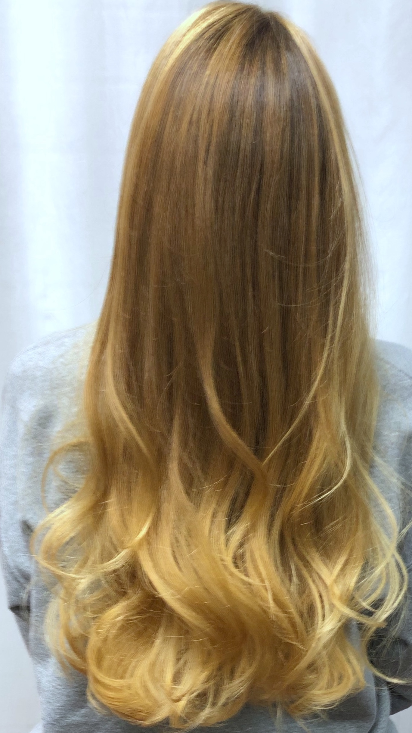 Look At That Dimension - Take a look at the balayage color design here. You can clearly see the transition achieved with low-lights fading to mid-lights and fading into highlights. Absolutely beautiful and natural looking.