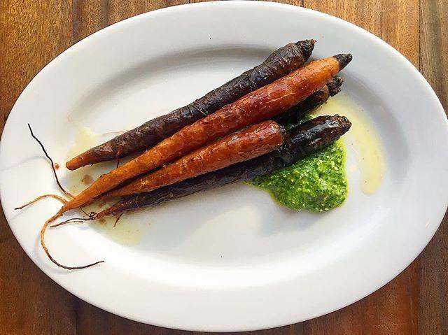 hay baked carrots, nasturtium, aged chèvre, pinenut . . . #asheville #avleats #riverartsdistrict #smallplates #vegetables #buylocal #pesto #nasturtium #eat #eats #eater #lefooding #eatstagram #food #foodporn #foodphotography #carrots