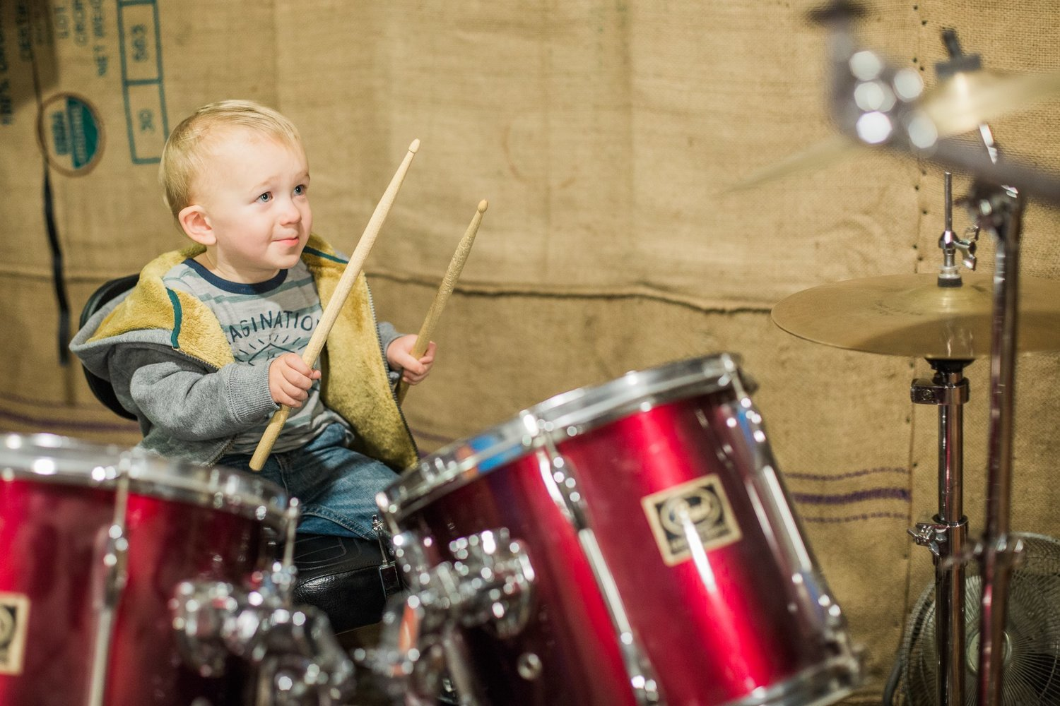 My son playing the drums at age 1. Standing to the right of the camera is his Papa, and my son's face tells you everything you need to know about how he feels right in that second.