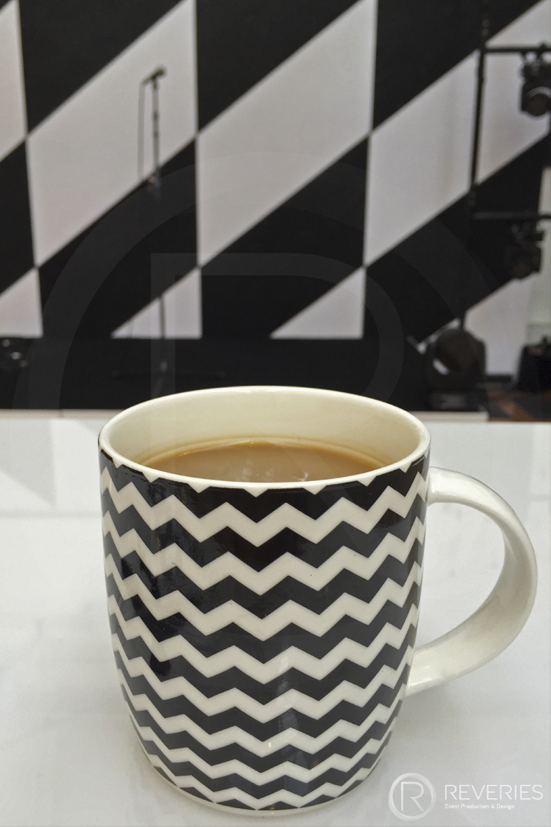 British Orthodontic Society Party - geometric themed backdrop and mug detail