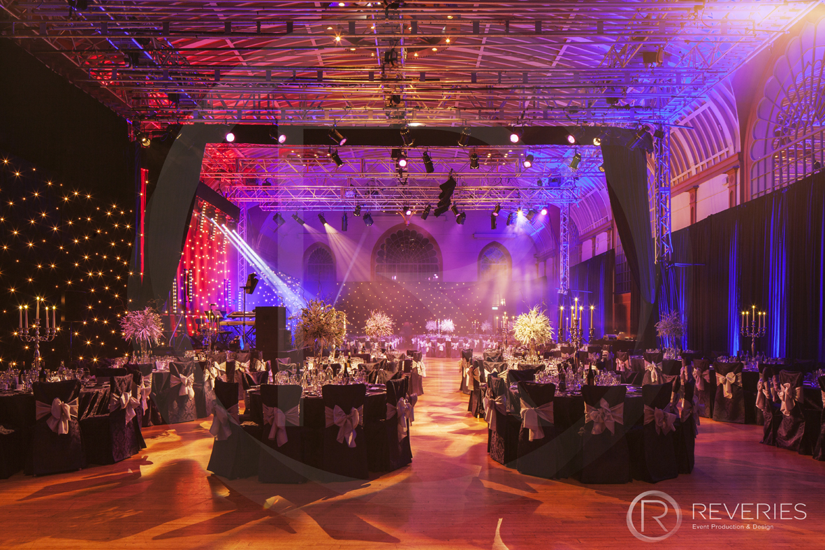 Gala Dinner - The room with table, stage, drapery and lighting design