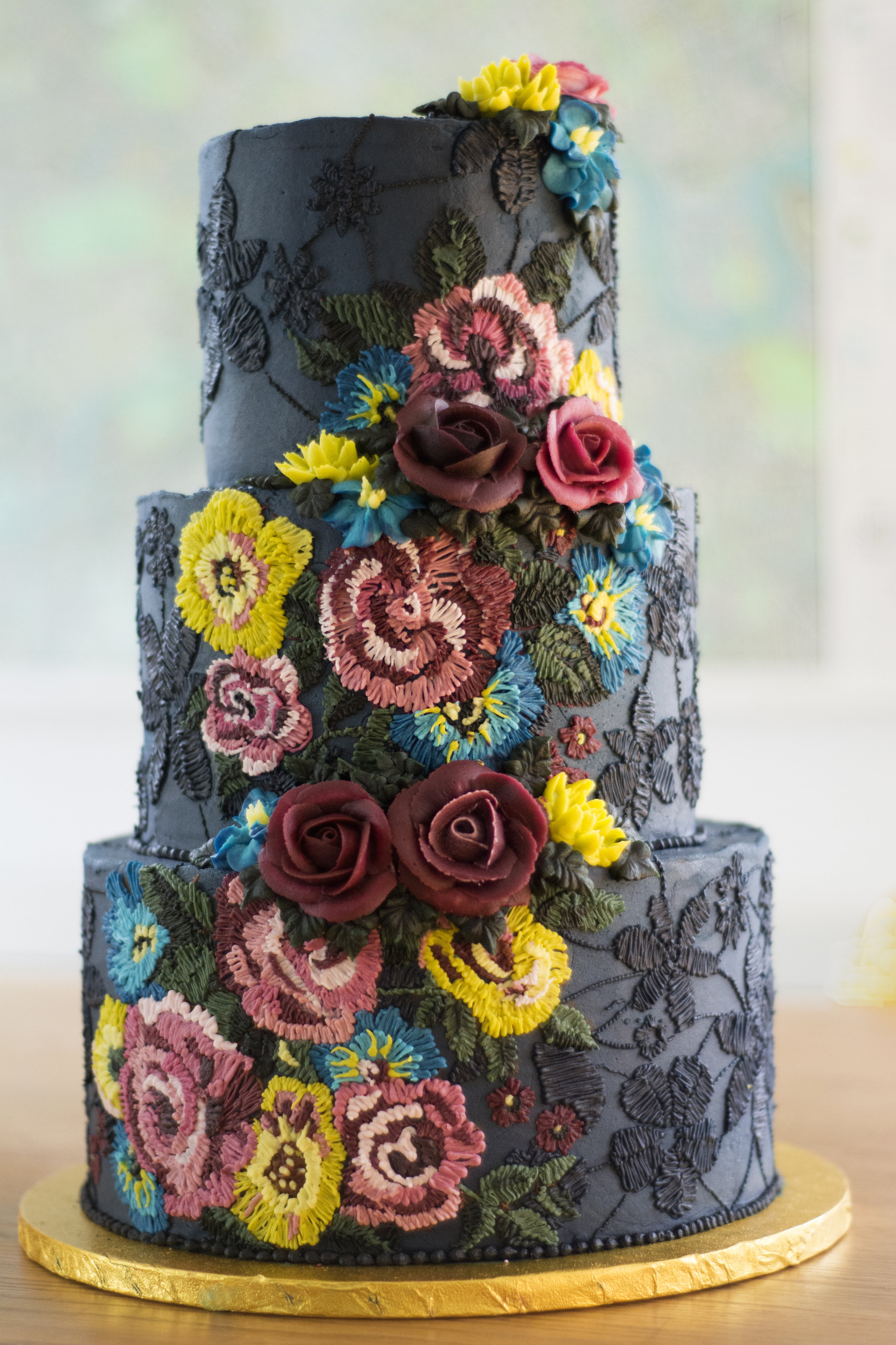 Black chocolate buttercream cake with embroidery piping by Emma Page Buttercream Cakes London