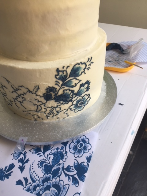 Piping to replicate the Dutch design of an invitation by Emma Page Butterceam Cakes London
