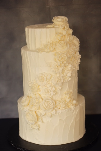 Rustic buttercream cake with same colour cascade £510