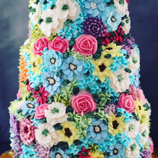 Buttercream cake smothered in bright florals £665.