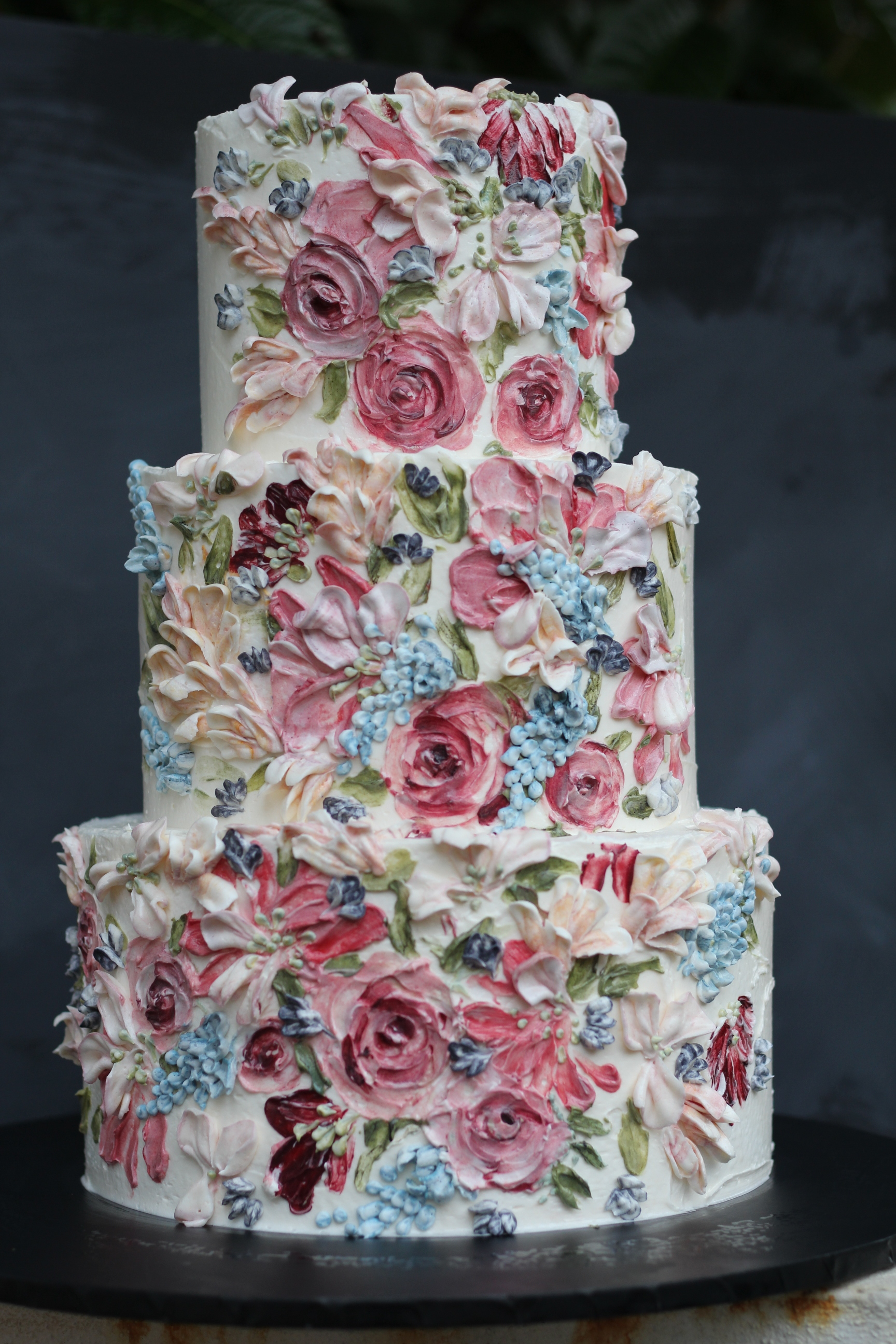 A three tier wedding cake serving 100