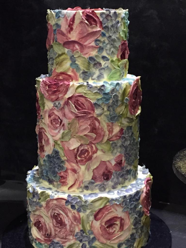 A three tier painted cake serving 120, £720