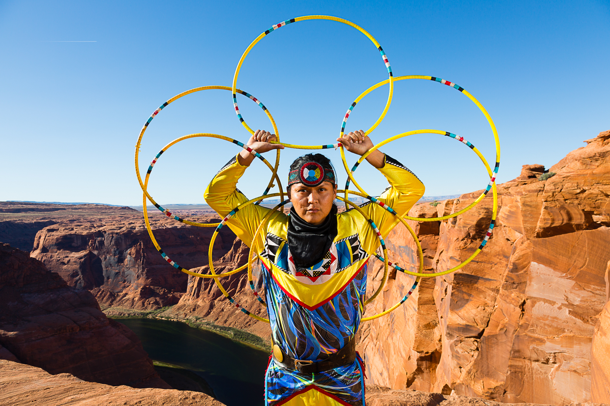 Native American hoop dancer Joseph Secody. Good looks, nerves of steel; the drop behind him is about a thousand feet. Canon 5D III, 24-105mm f/4 at f/11 and 1/100th of a second. Off-camera strobe in an octobox.