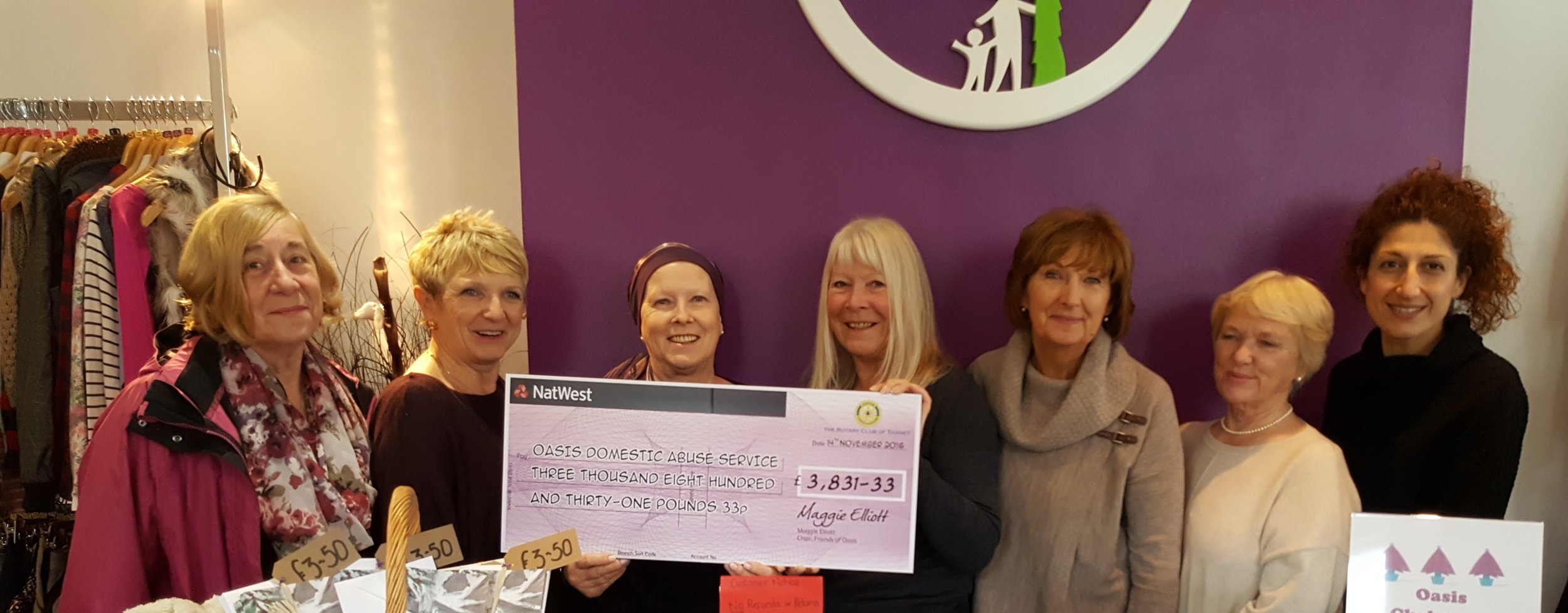Friends of Oasis present a cheque to Oasis