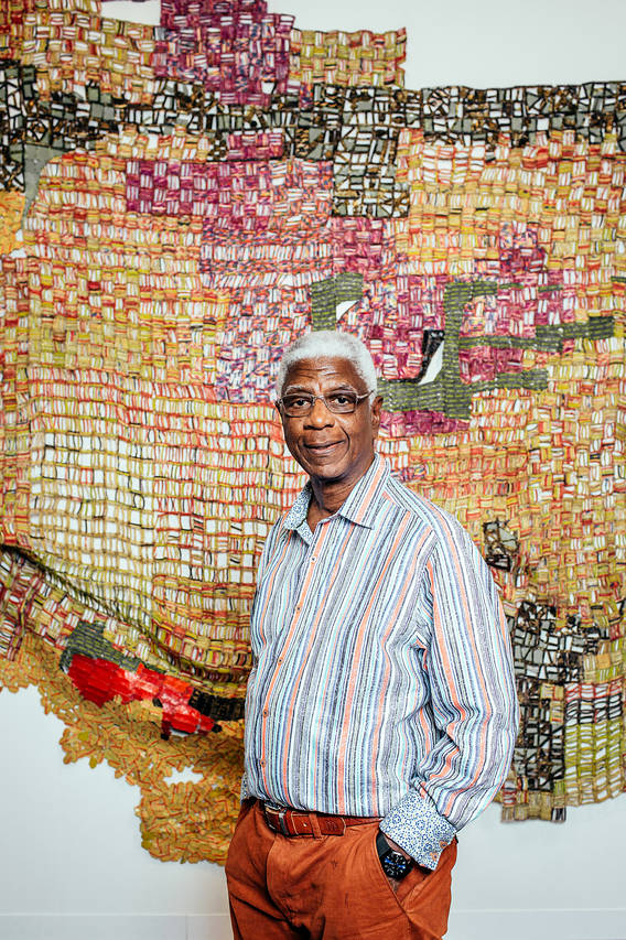 El Anatsui in front of his 2016 'Trova' sculpture Photo: Annie Tritt for The Wall Street Journal