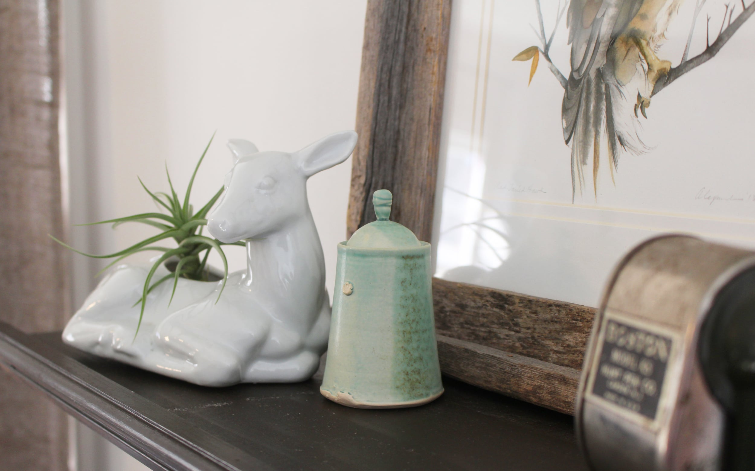 One of my favorite areas in my studio. The little sea-foam green jar is from  Illyria  Pottery. I love her work!