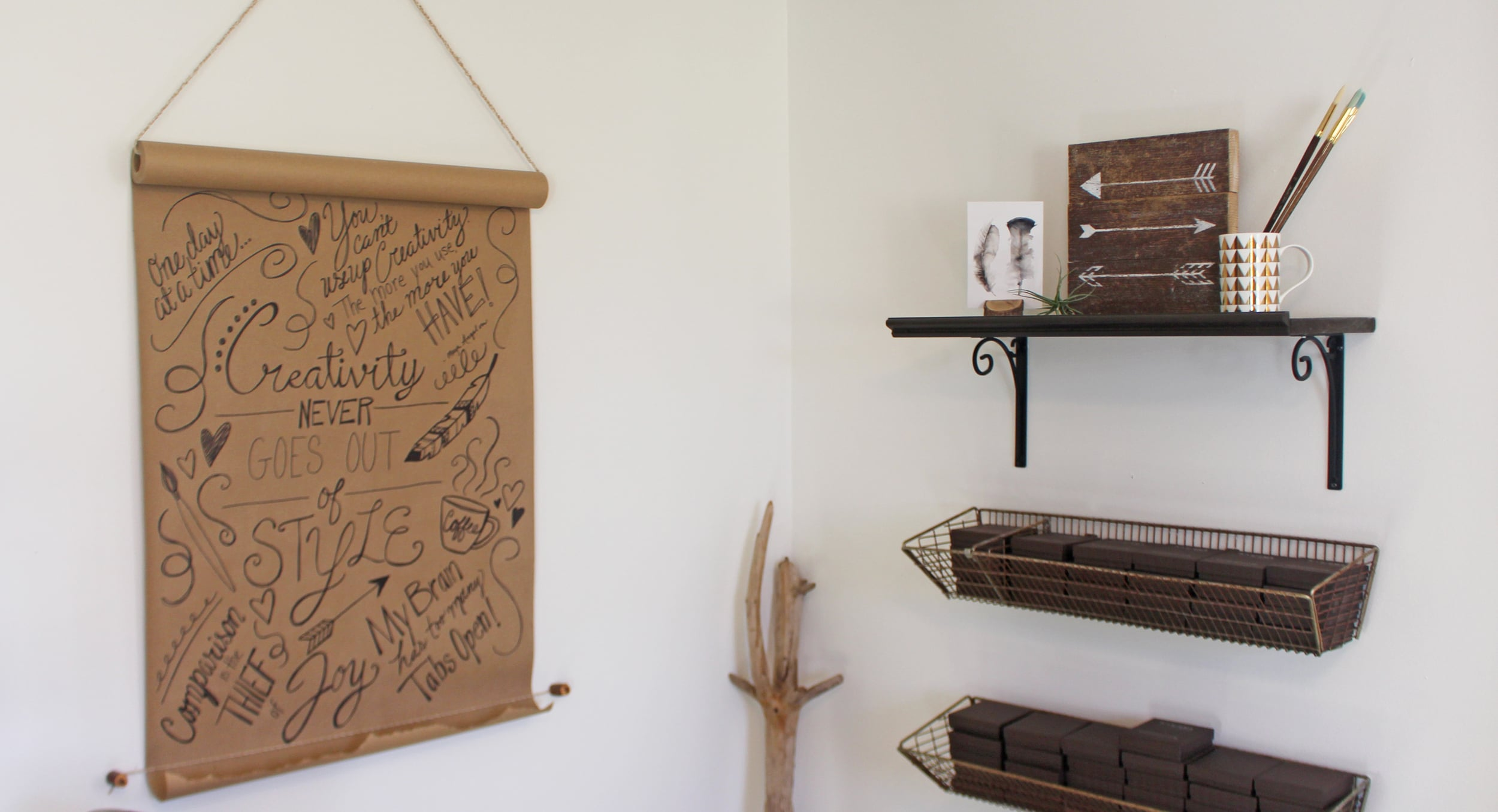 This is my packing corner. The wooden arrow piece is from  Olive + Grey . They also made my signs for me.