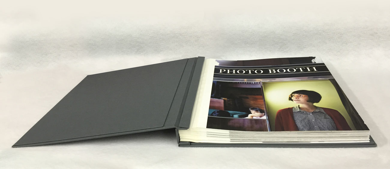 Smoke Fabric Scrapbook Portfolio with tape-hinged prints.