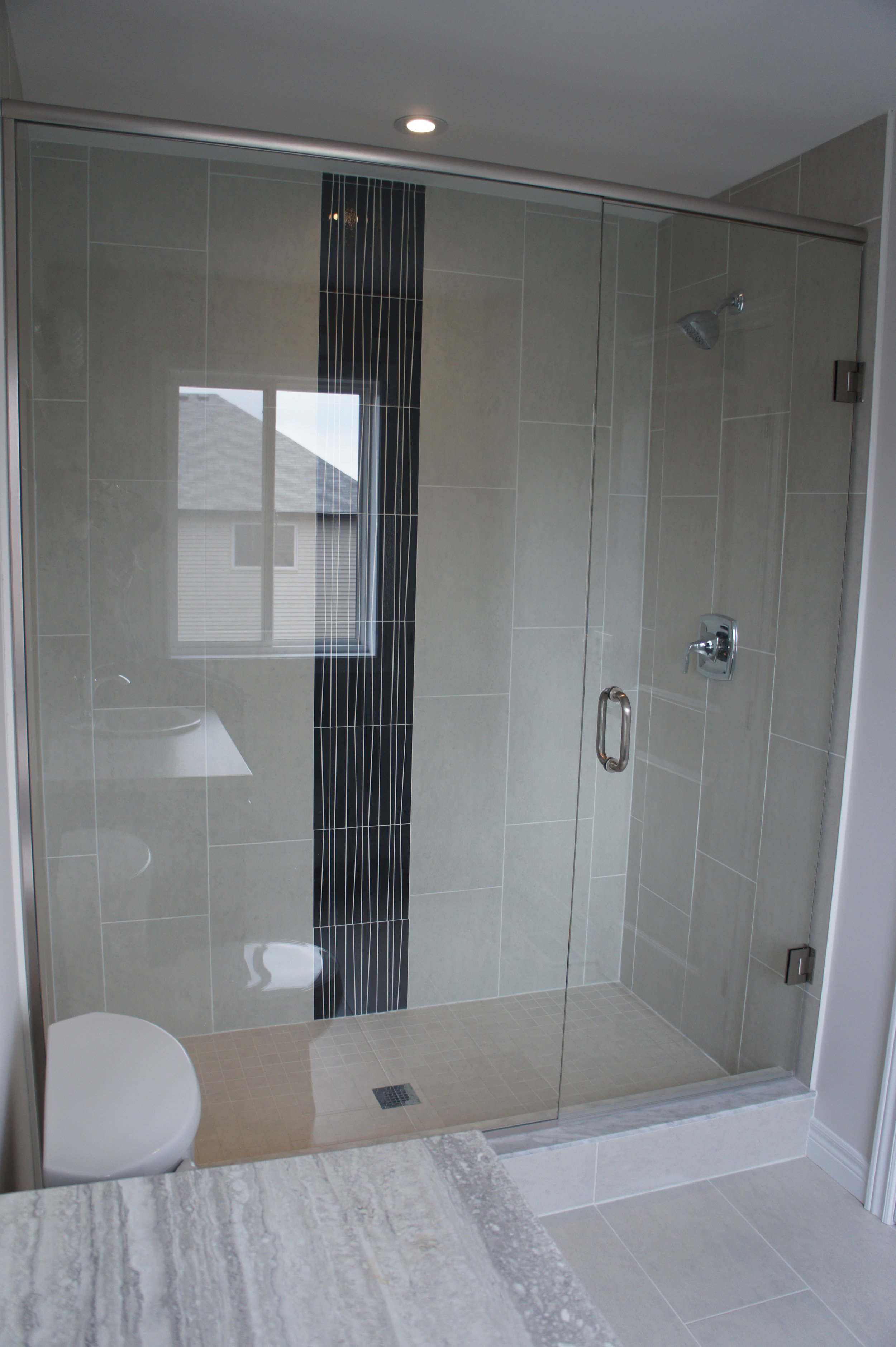 """Frameless Glass Shower   Adding a glass shower to your bathroom creates a modern and elegant """"spa like"""" look. Your bathroom will sparkle and appear larger because the glass will allow light to flow through the room."""