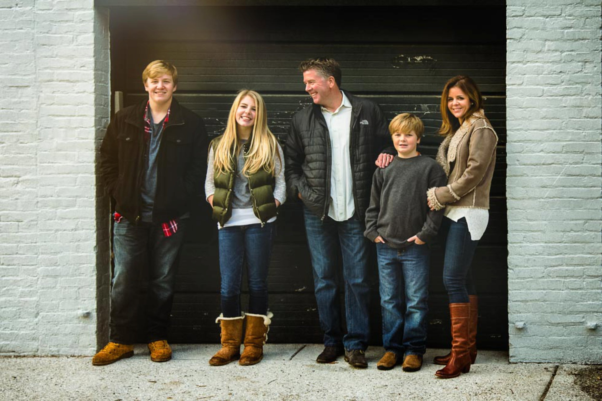 Amazing color image of family of five in urban scene.