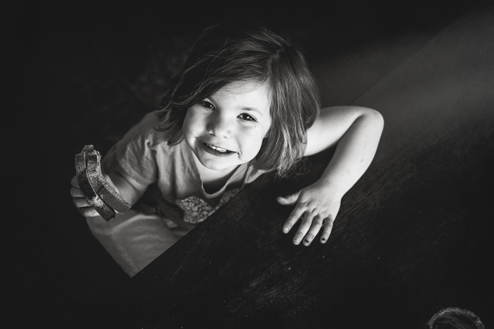 smiling at the camera in black and white