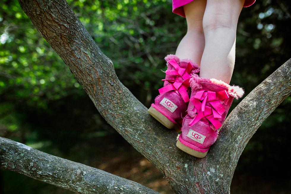 pink ugg boots climbing a tree
