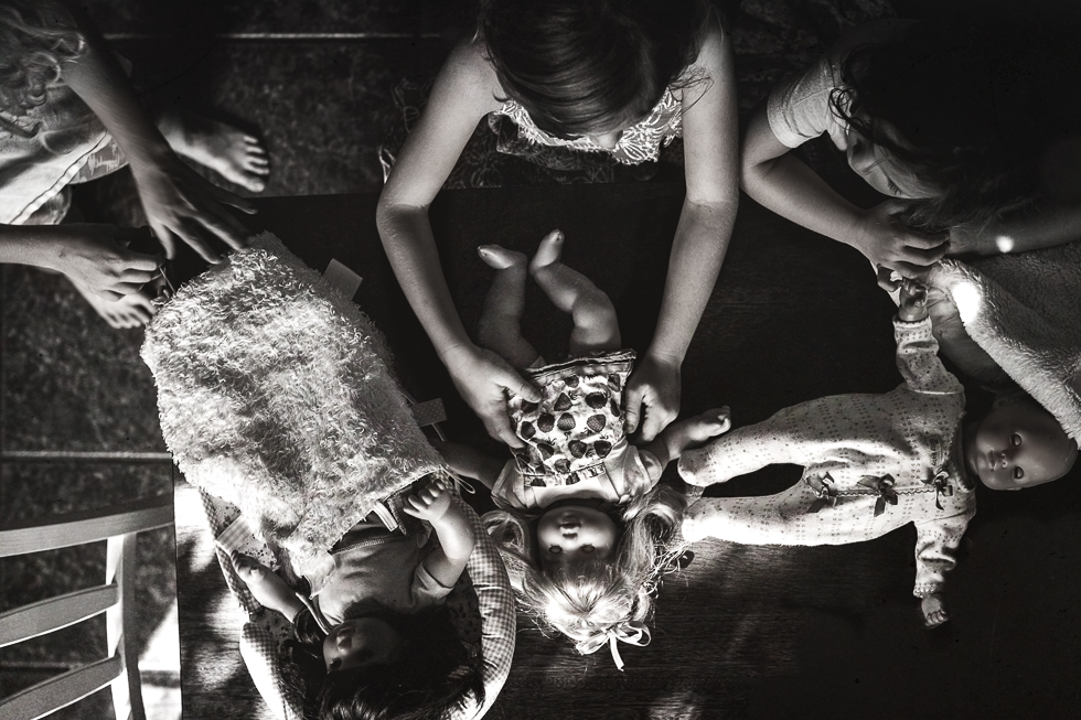 Black and white of girls playing with dolls