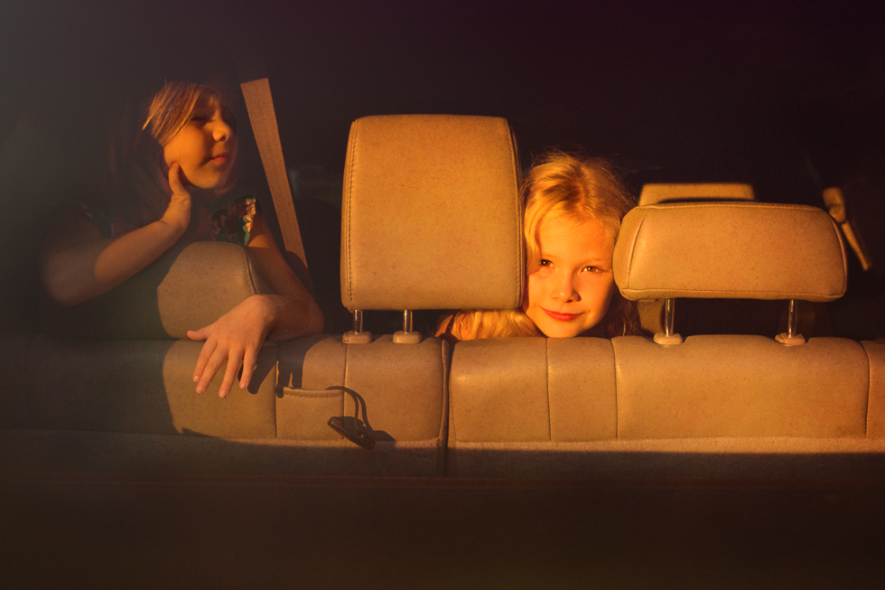 girls in car bathed in golden sunset