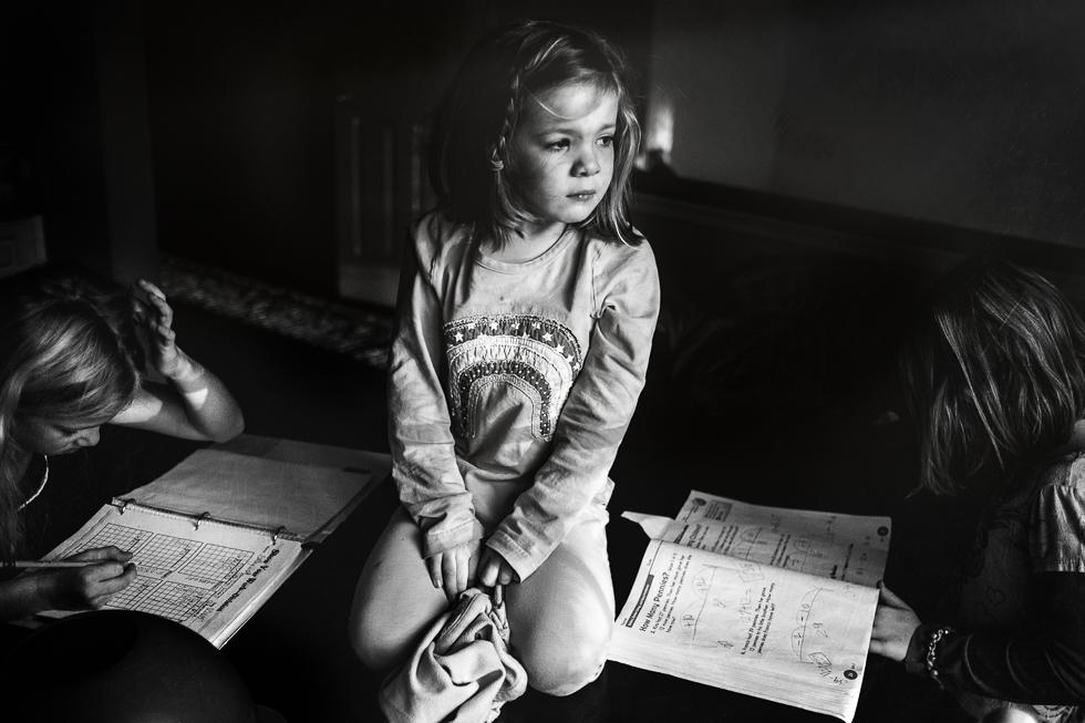 pouting girl sitting on kitchen table