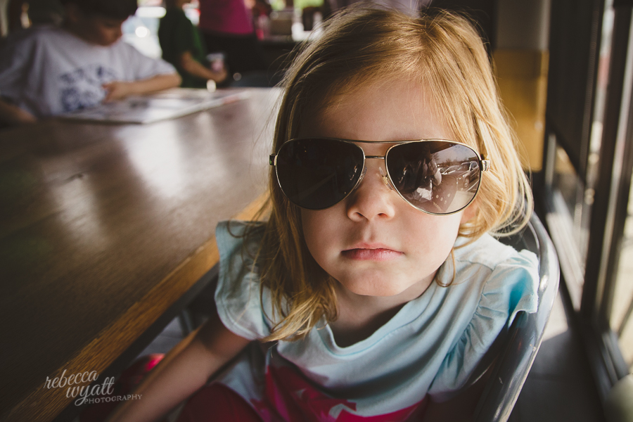 Girl in Sunglasses Indoors