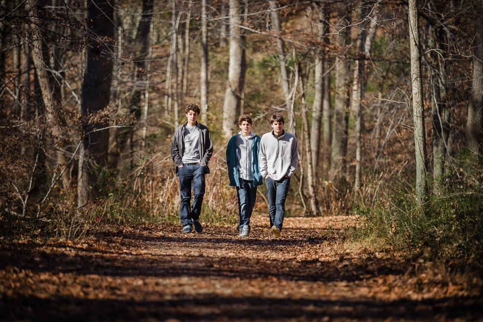 Copy of Teenage boys walking through the woods.
