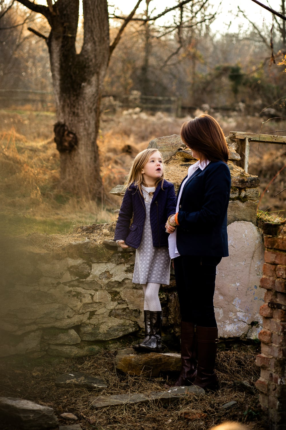 Sweet mother and daughter moment with them talking together in outdoor location.