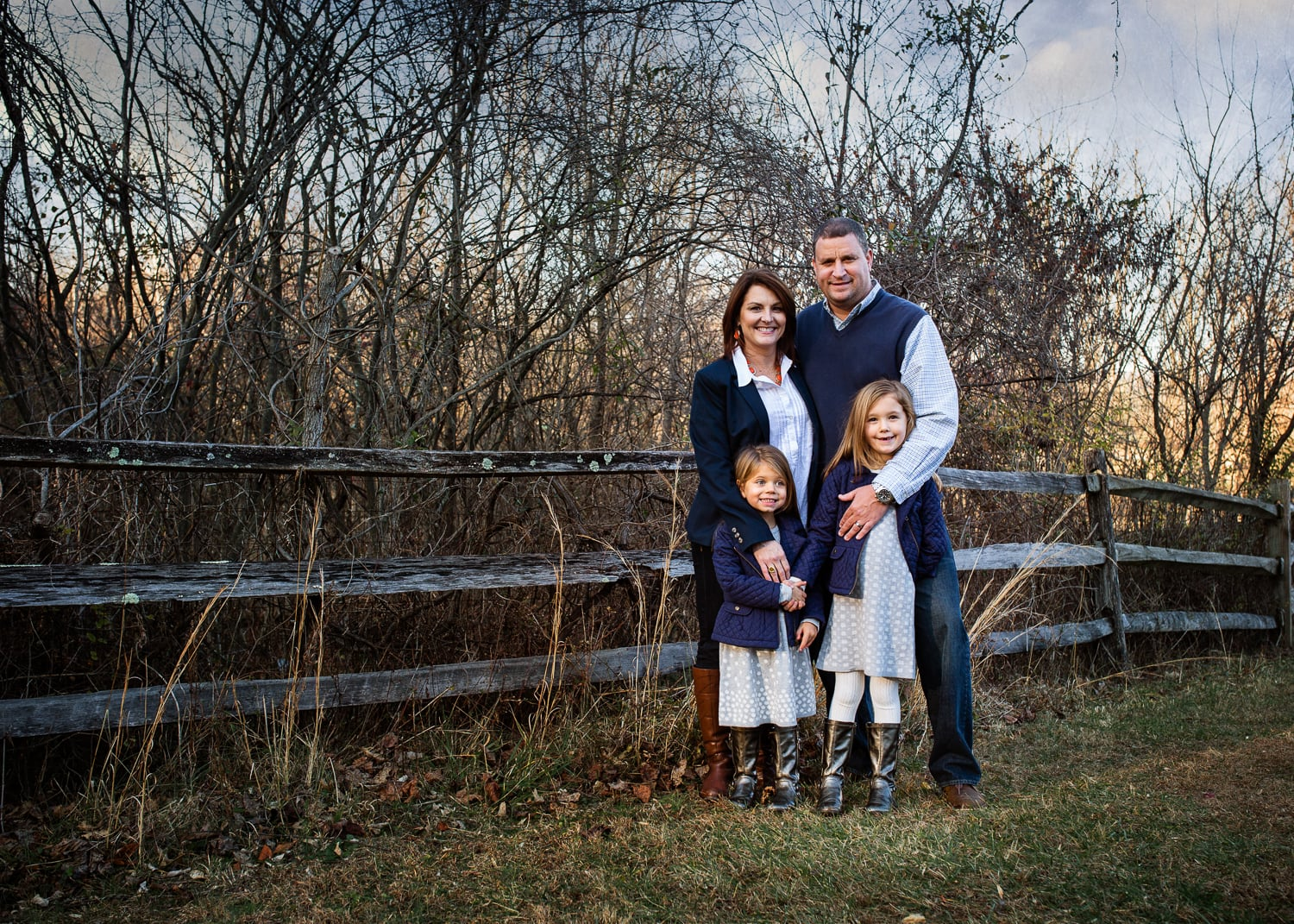 Photograph of mother, father and two girls by fence in Hunt Valley, MD