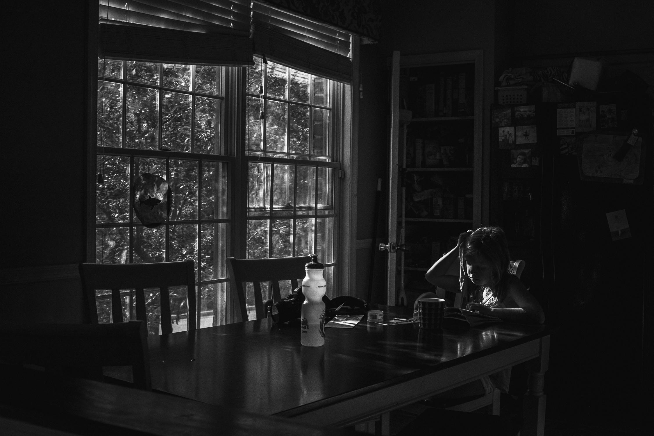 365.3.rebecca_wyatt_reading_by_window-1.jpg
