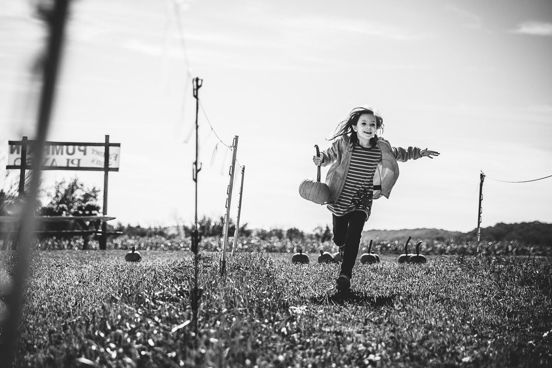 REBECCA_WYATT_Pumpkin_farm_running_girl_reg-1.jpg