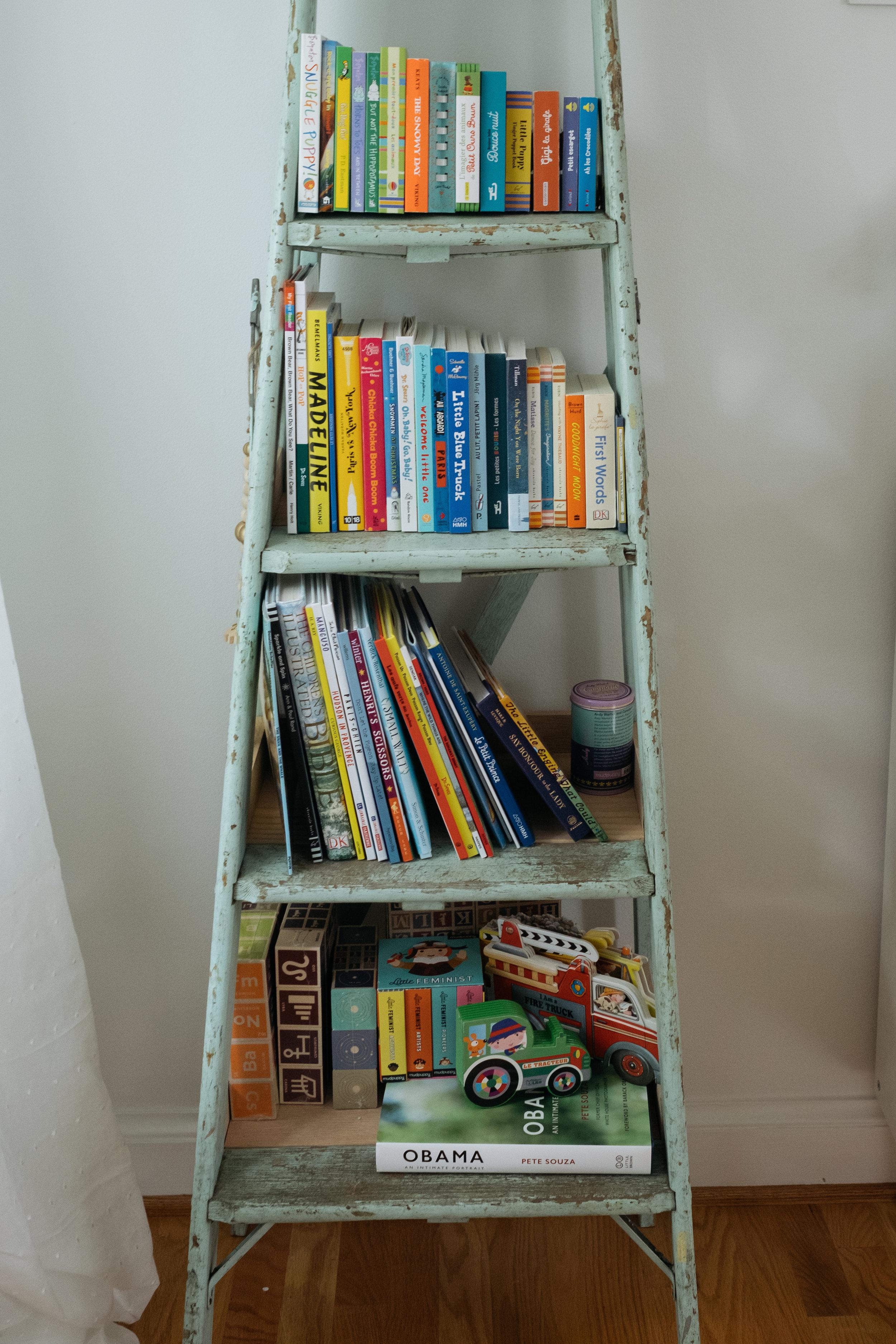 book display in corner of newborn's nursery