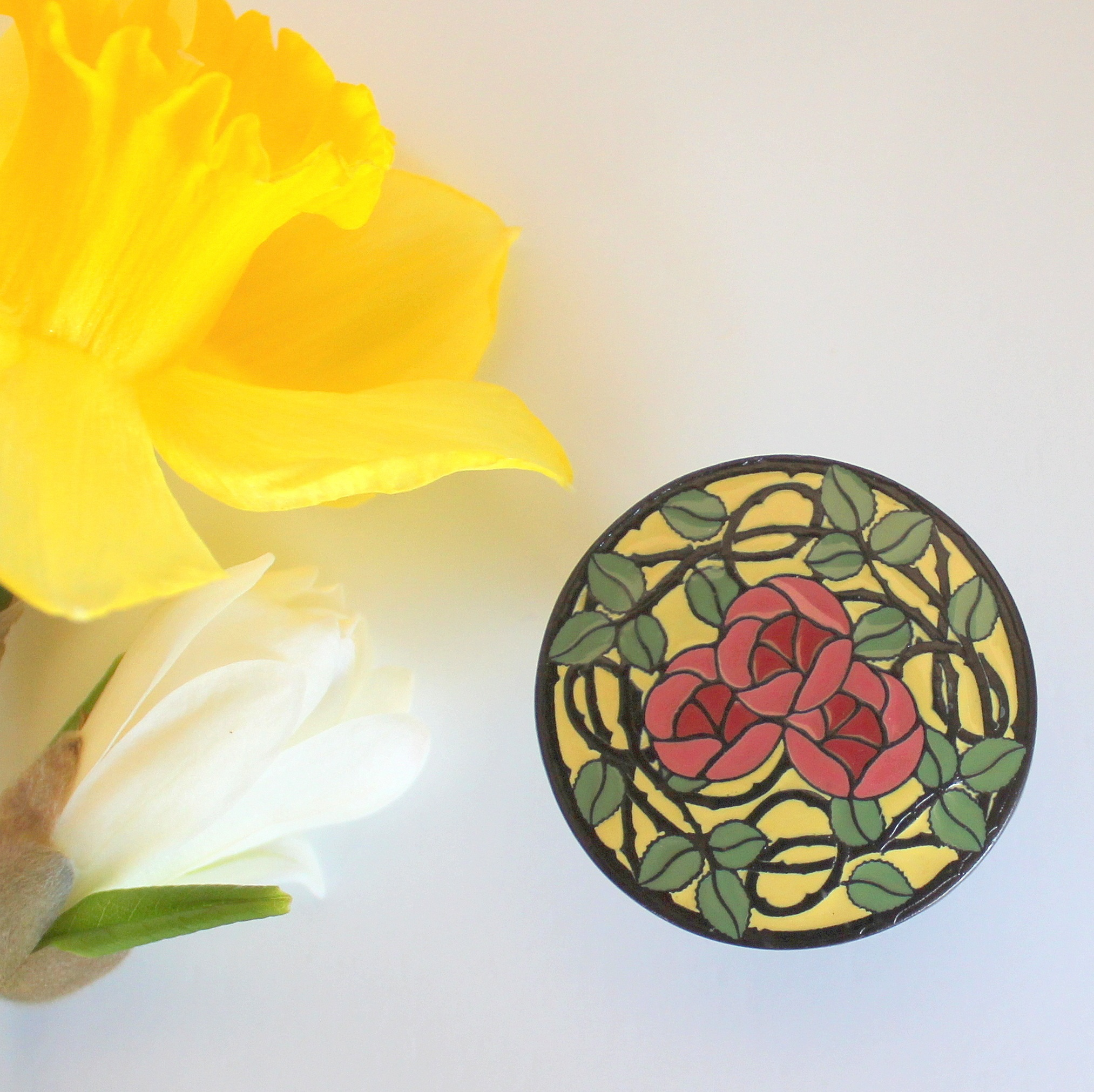 Delaney's Rose Knob in Dark Brass with Yellow