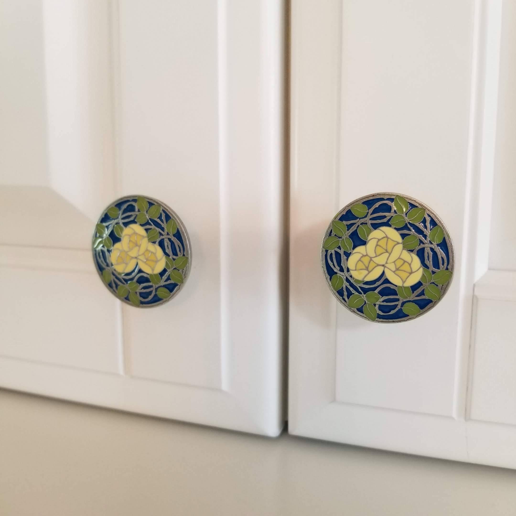 Delaney's Rose knobs in blue enamel.jpg